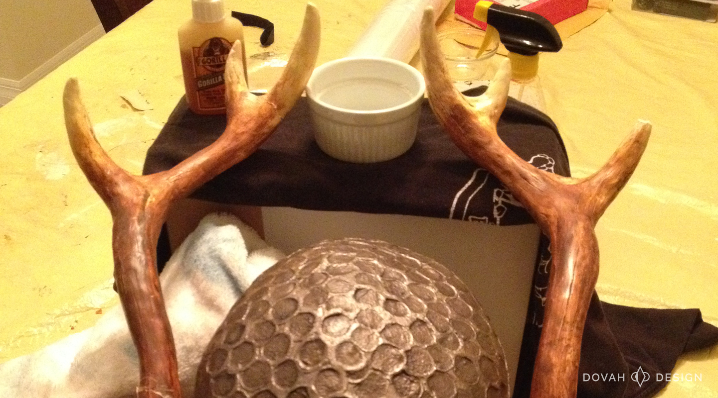 Nord helmet repair, close up of the stand I rigged to hold the antlers as the glue hardened.