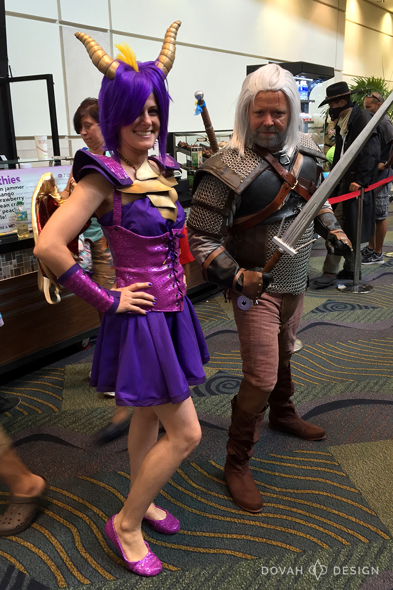Spyro the dragon cosplay posing with Geralt of Rivia (The Witcher) at MegaCon 2016