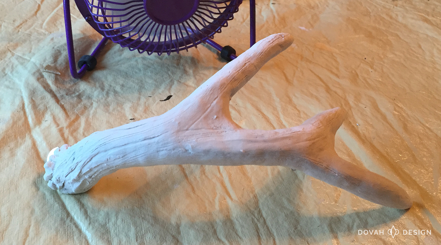Clay completed on antler, drying in front of fan