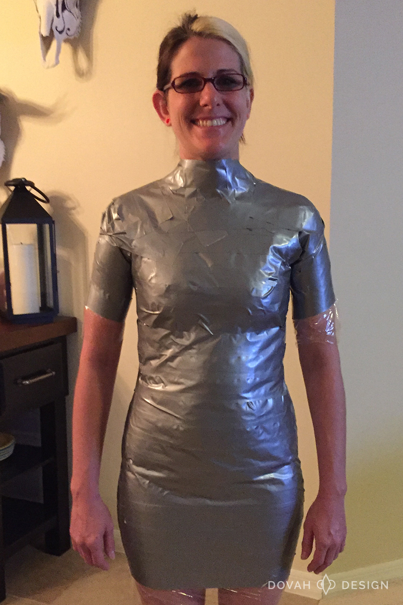 Sam fully wrapped in duct tape, facing forward.
