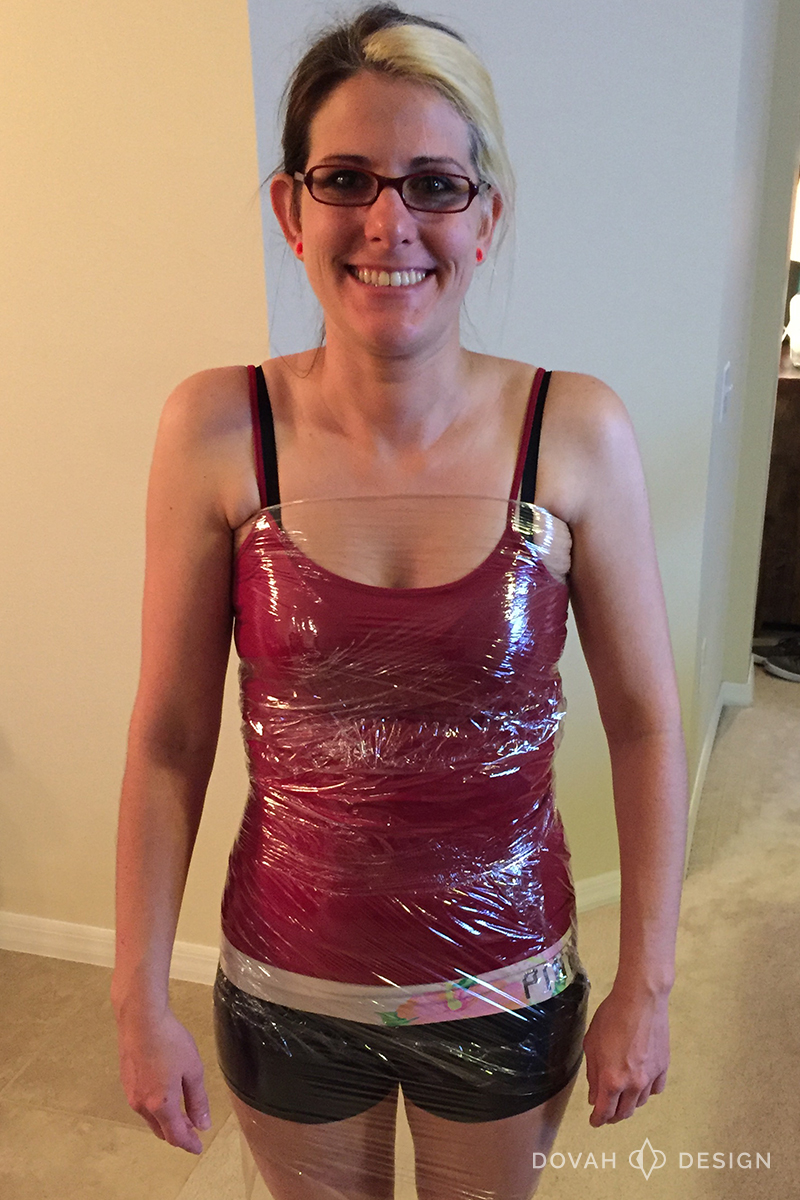 Sam, body wrapped up to armpits in plastic wrap.
