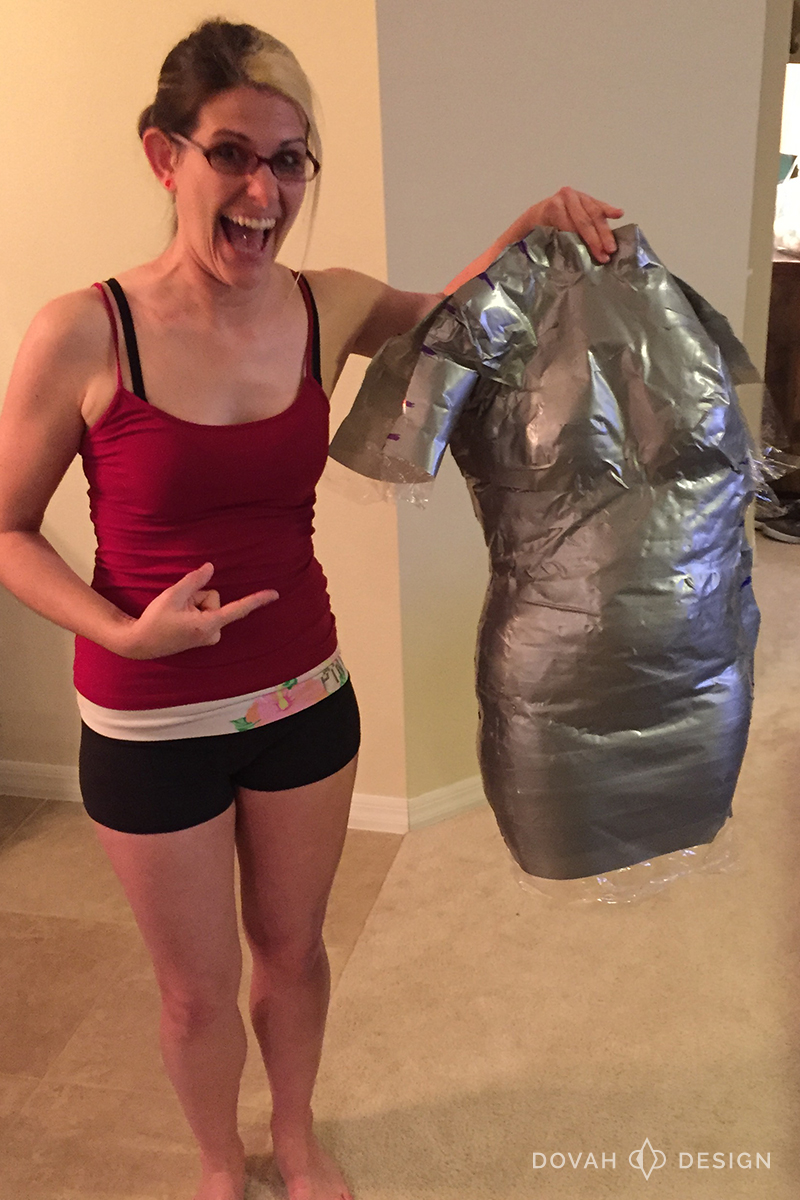 Sam showing off her duct tape shell after being cut free from the duct tape.