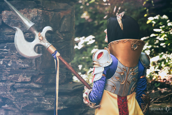 Snow White Disney Princess Armor, standing in the woods near an old stone wall. Back view of breastplate and collar, colorized